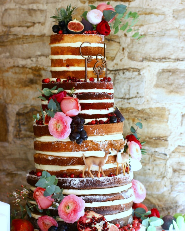 Four tier naked wedding cake with figs, grapes and flowers for a rustic barn wedding at Swallows Oast, Ticehurst