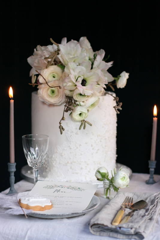 Elegant wedding cake with edible lace and pearls