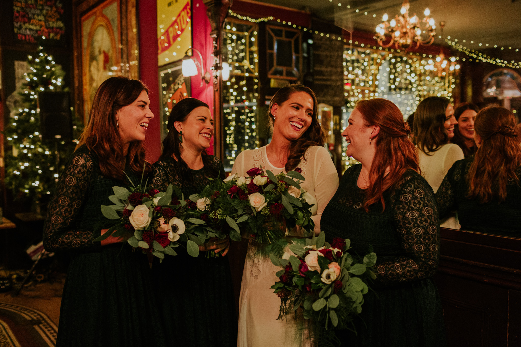 Bride with her bridesmaids at The Peasant, London in December wedding. Photo by Maja Tsolo
