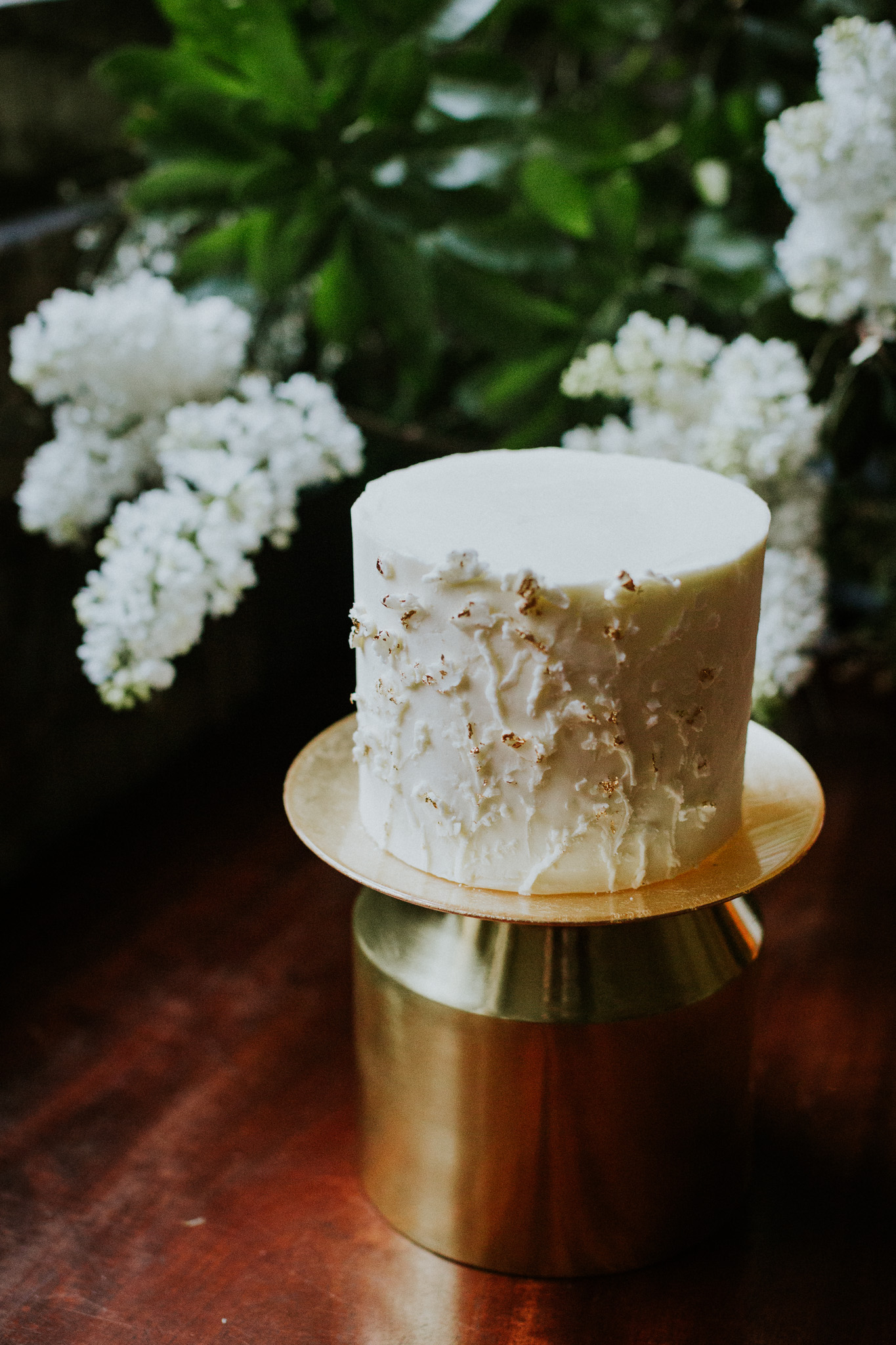 Bas-relief sculptured buttercream wedding cake with natural, organic floral details. Photo by Maja Tsolo