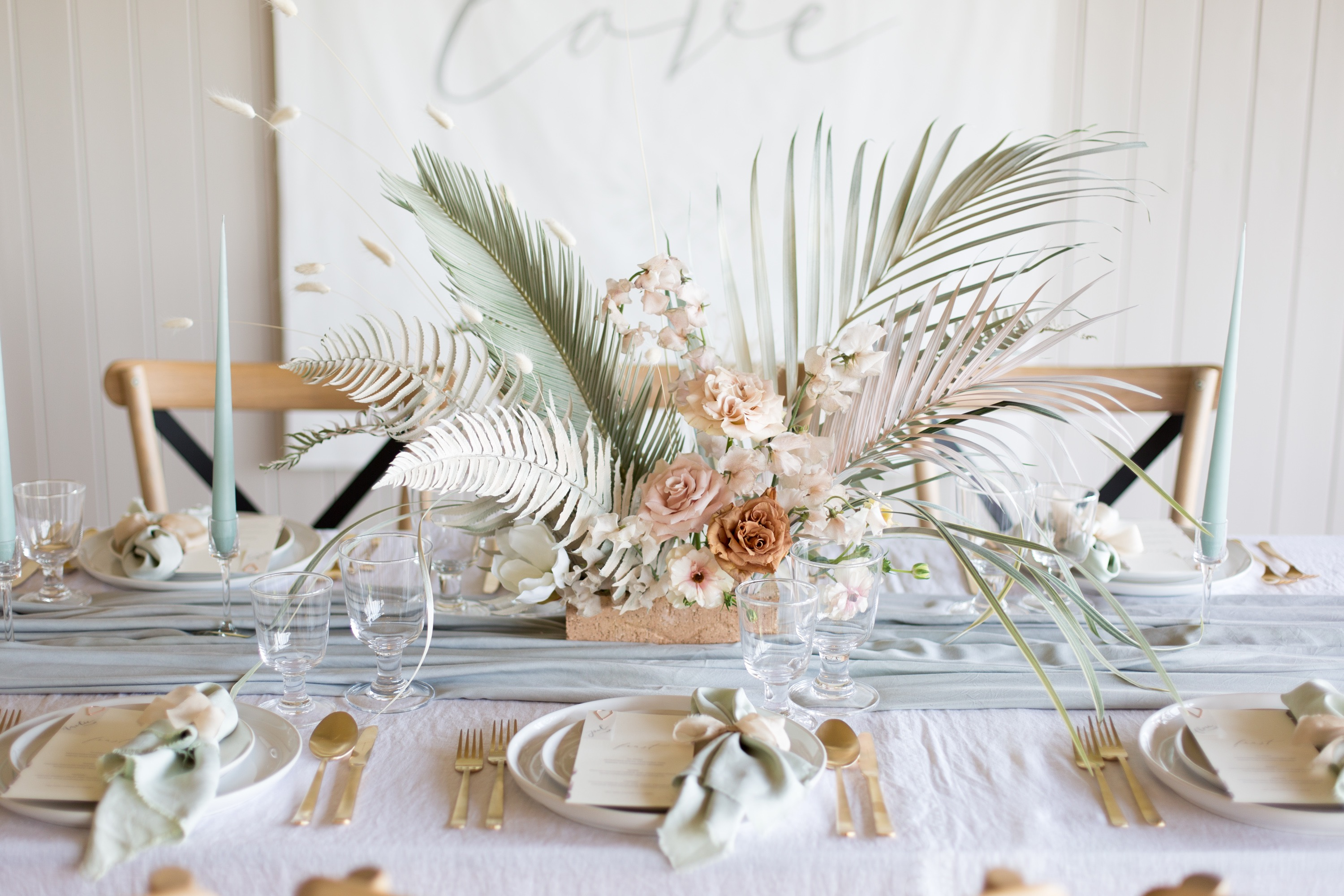 Modern, contemporary floral arrangement for a British meets Bondi wedding style