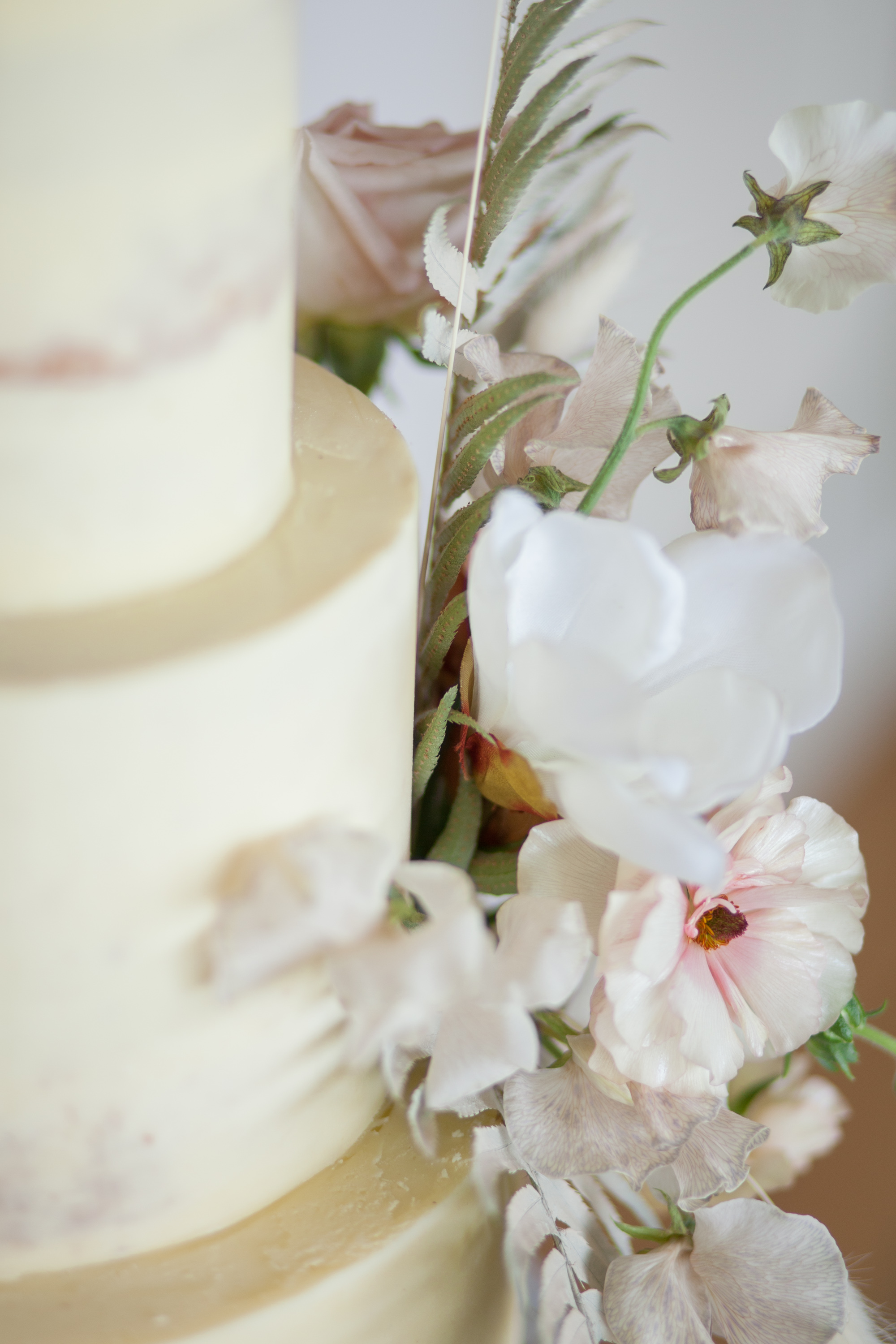 Sleek, sharp edges and floral details on this buttercream wedding cake