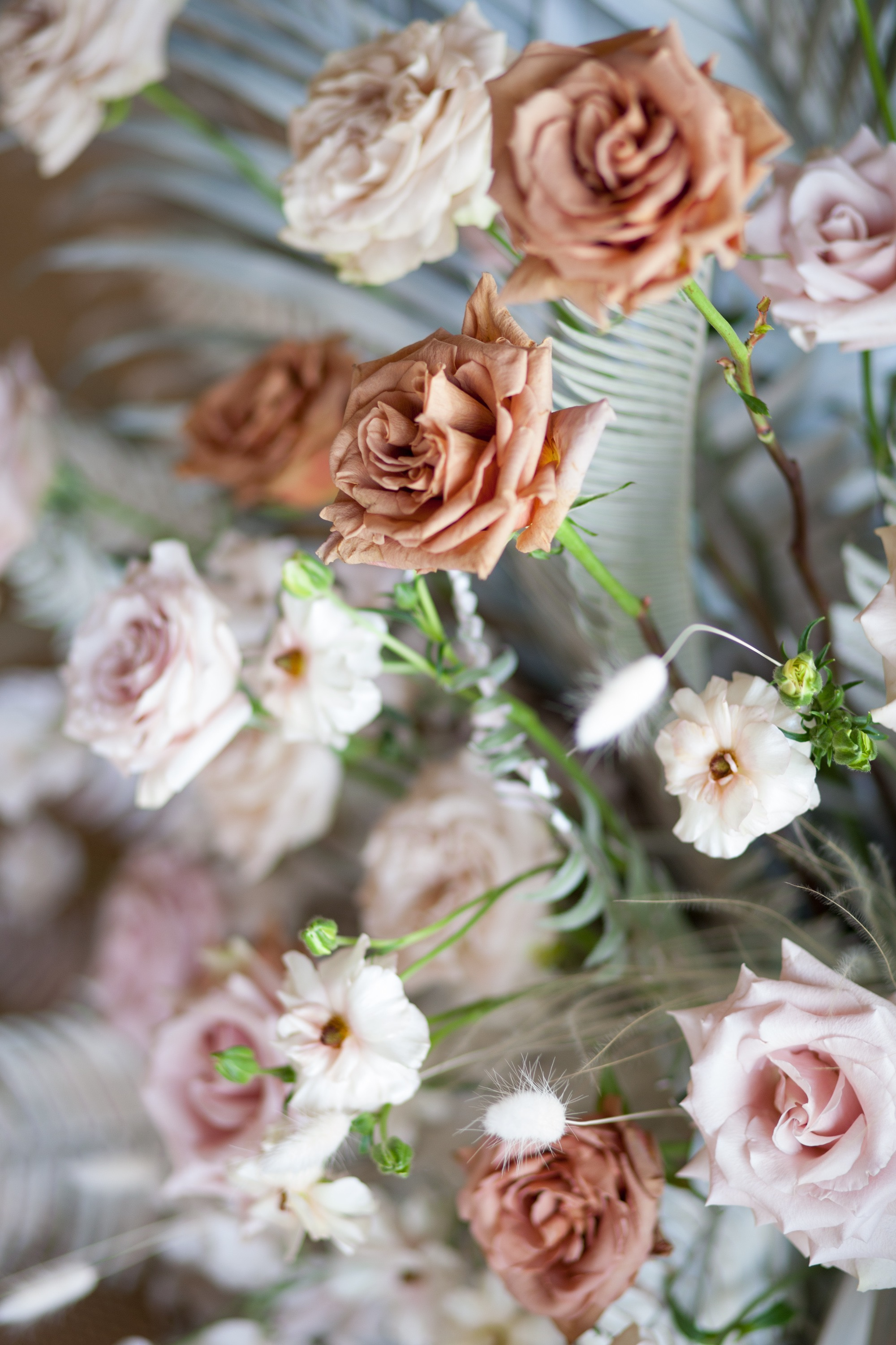 Modern boho wedding flowers in blush pink , ivory and toffee