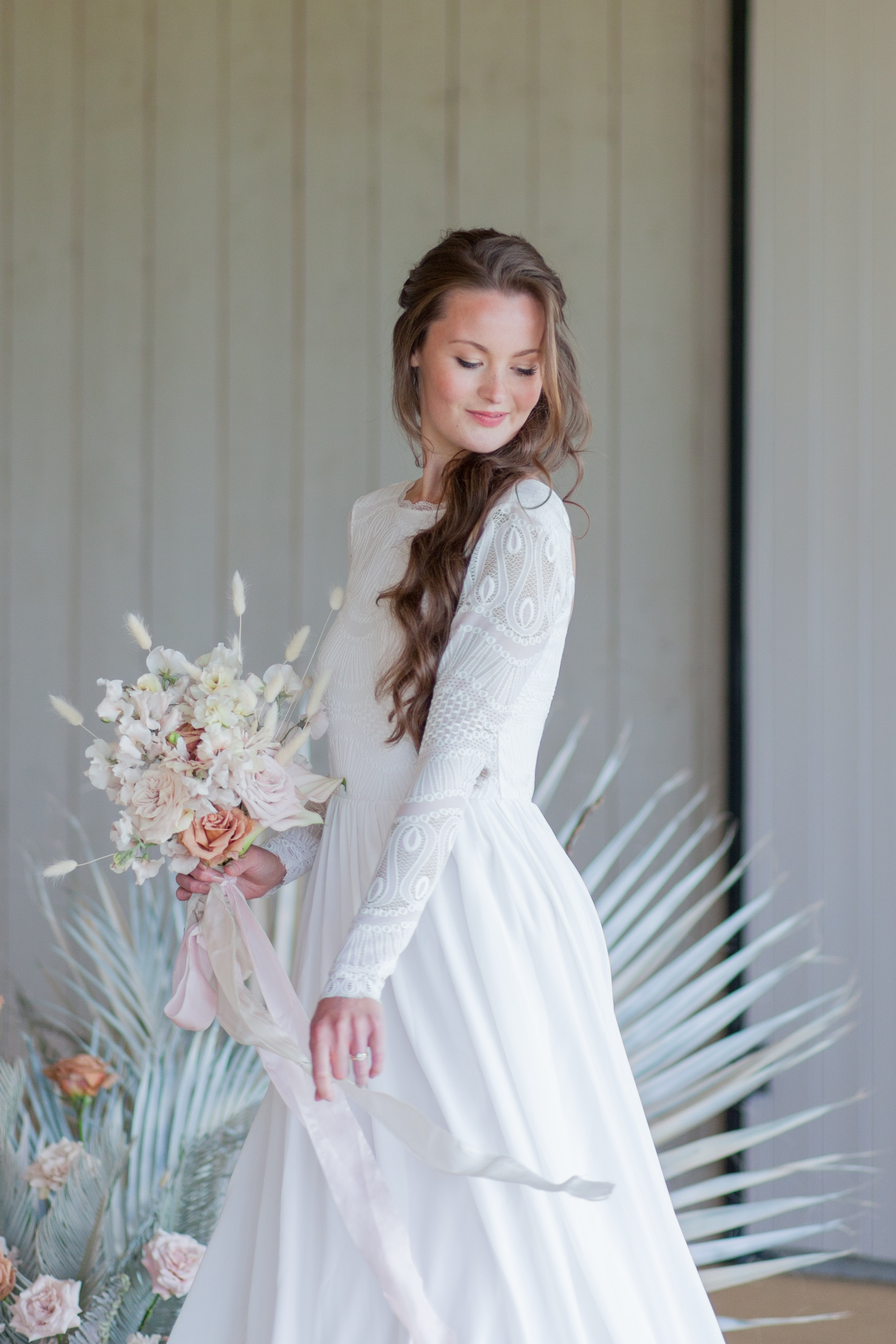 Relaxed, beachy vibes in this wedding gown from Luella's Bridal