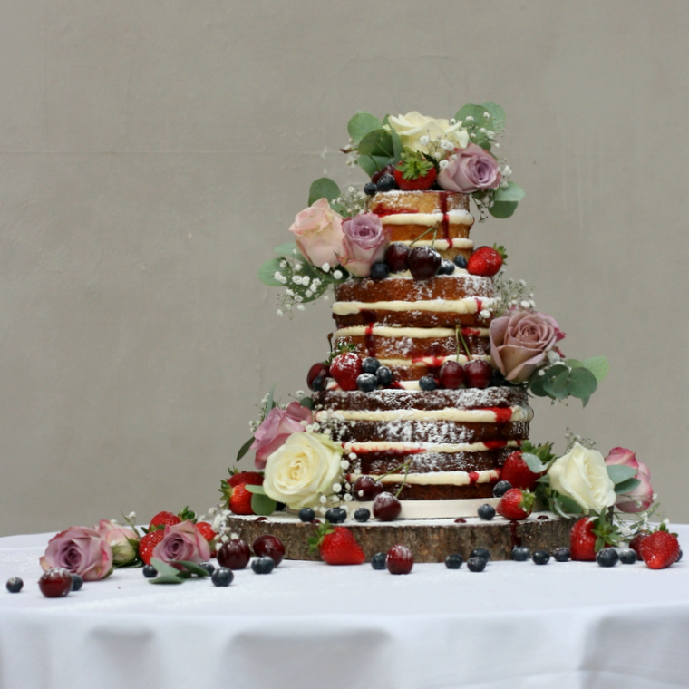 Three tier luxurious naked cake with fresh flowers at Hampton Court House
