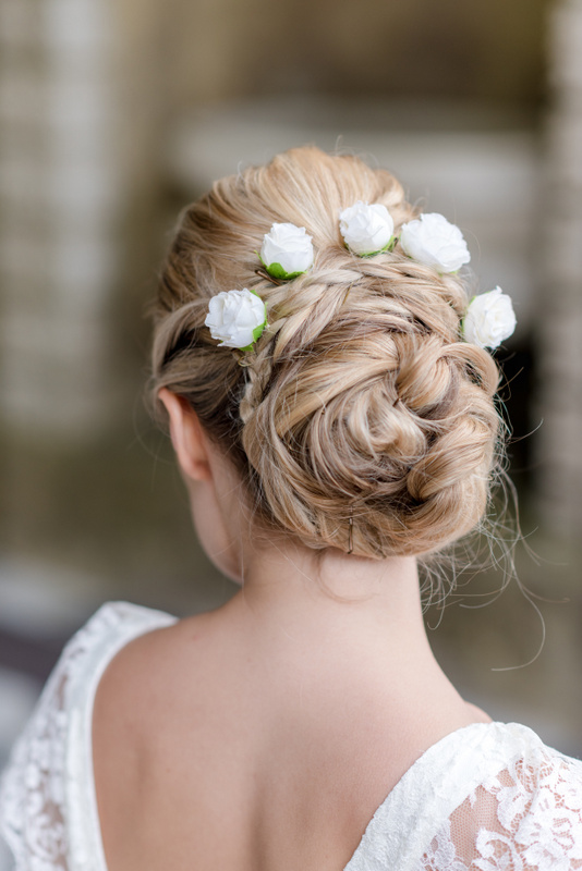Pretty and romantic bridal hair for a wedding at Wotton House, Dorking, Surrey. Photo by Neli Prahova