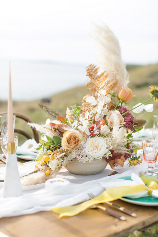 Wedding flowers by Bloomologie and table styled by Willow & Oak at Lulworth Cove on the South Coast of England