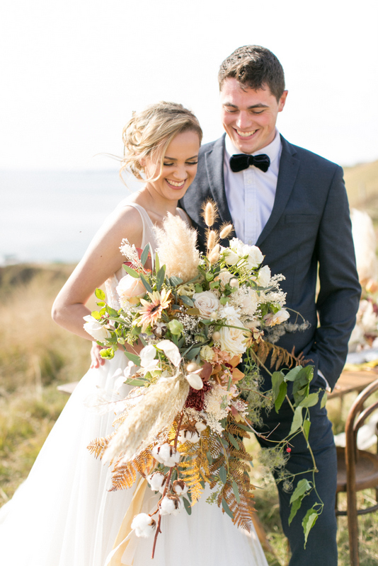 Bride & groom in summer coastal wedding. Photo by Anneli Marinovich