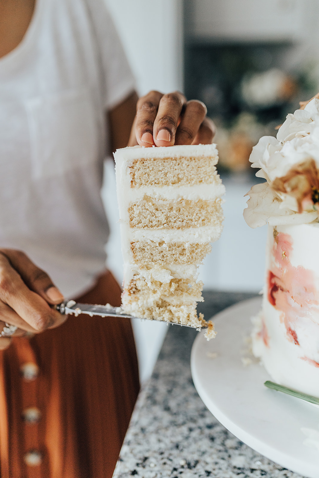 A tall slice of buttercream cake | Sugar Plum Bakes | Rebecca Carpenter Photography