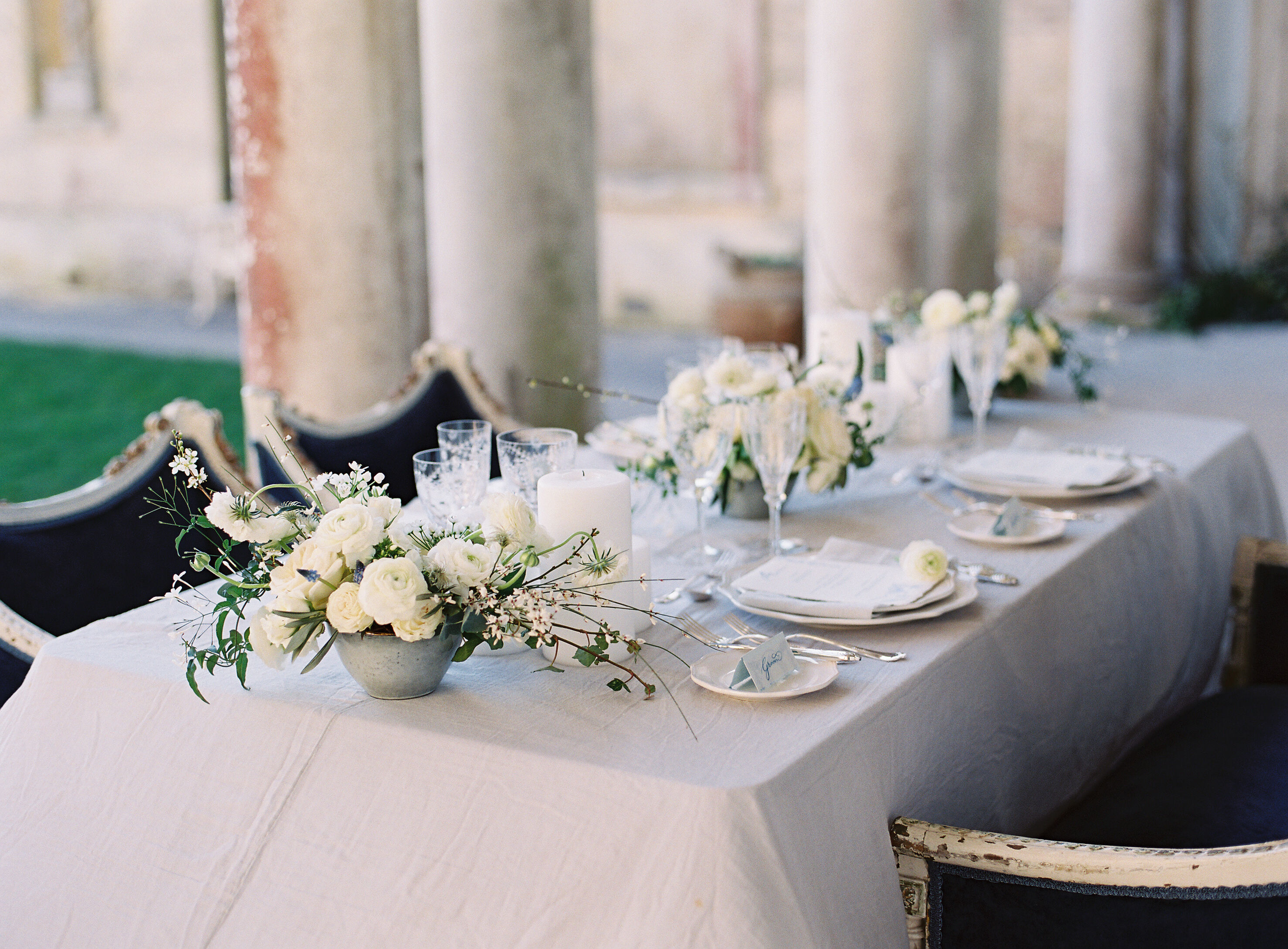 Romantic tablescape with Spring flowers for Somerley House wedding inspiration. Photo by Camilla Arnhold