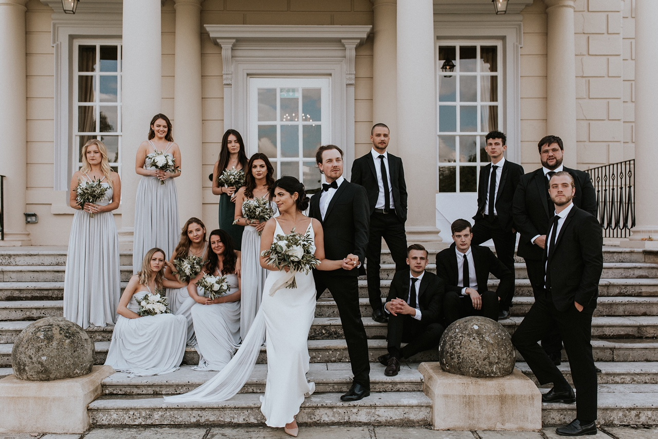 Bridal party at Buxted Park Hotel, Sussex. Photo by Nataly J Photography