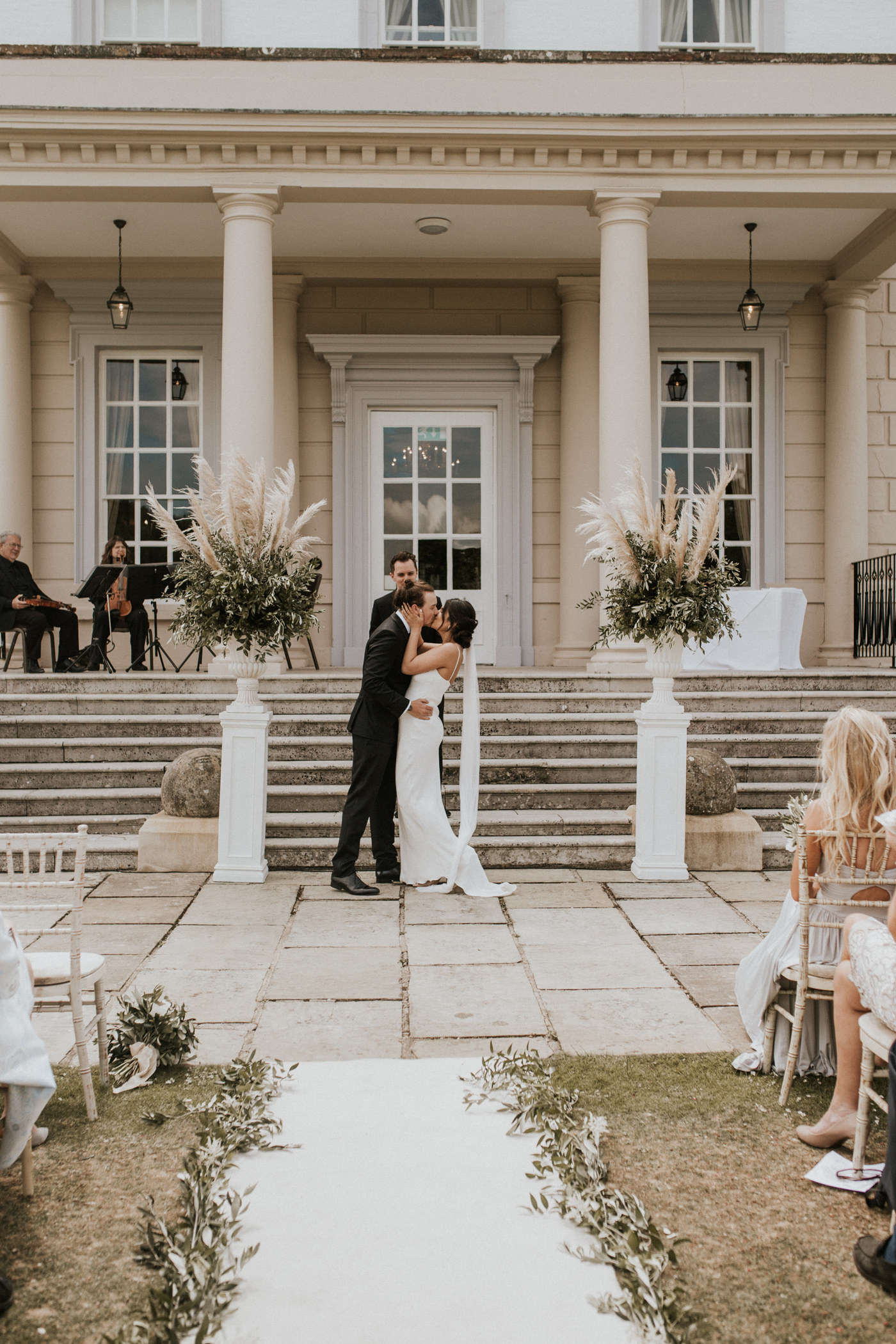 Outdoor wedding ceremony at Buxted Park Hotel, Sussex. Photo by Nataly J Photography